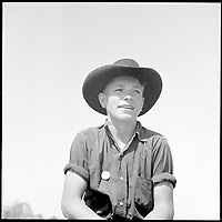 San Joaquin Valley, California. Contract Labor. Sixteen years old and the possessor of a labor contractor's button... - April 1940<br /> <br /> Partridge, Rondal, 1917-, Photographer (NARA