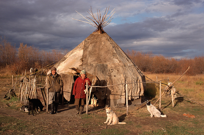 Two Chukchi women outside their reindeer skin yurt near Khailino. Koryakia, Kamchatka, Siberia, Russia