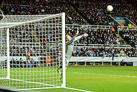 14.03.2013 Newcastle, England. Newcastle's Rob Elliot dives against a late second half free kick from just outside the box in action during the Europa League game between Newcastle and Anzhi Makhachkala from St James Park.