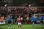 Fleetwood Town 1 Wrexham 1, 10/04/2012. Highbury Stadium, Football Conference Premier. Away fans reacting with delight as Jake Speight gives their team the lead as Fleetwood Town (in red) host Wrexham in a Blue Square Conference Premier match at Highbury Stadium. The match, between the top two teams in the division ended in a 1-1 draw watched by a near-capacity crowd of 4996. A victory for the hosts would have seen the club promoted to the Football League for the first time. Photo by Colin McPherson.