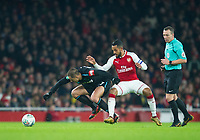 West Ham's Chicharito and Arsenal's Theo Walcott during the Carabao Cup QF match between Arsenal and West Ham United at the Emirates Stadium, London, England on 19 December 2017. Photo by Andrew Aleksiejczuk / PRiME Media Images.