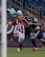 Chivas USA forward Justin Braun (17) crosses the ball as New England Revolution midfielder Chris Tierney (8) closes. In a Major League Soccer (MLS) match, Chivas USA defeated the New England Revolution, 3-2, at Gillette Stadium on August 6, 2011.
