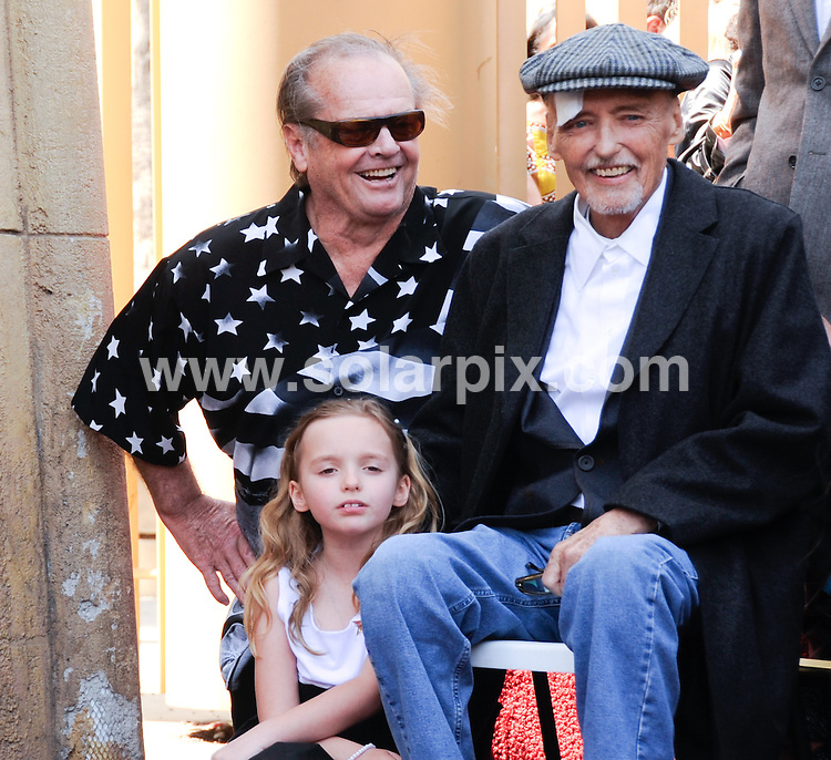 **ALL ROUND PICTURES FROM SOLARPIX.COM**.**SYNDICATION RIGHTS FOR UK, AUSTRALIA, DENMARK, PORTUGAL, S. AFRICA, SPAIN & DUBAI (U.A.E) & ASIA (EXCLUDING JAPAN) ONLY**.Dennis Hopper is honored With A Star On The Hollywood Walk Of Fame - 6712 Hollywood Blvd, Hollywood, CA. USA..The aging film star looked old and disheveled with a plaster over his eye and a bandaged hand..This pic:   Dennis Hopper with daughter Galen and Jack Nicholson.JOB REF:     PHZ/ Ortega    DATE: 26.03.10.**MUST CREDIT SOLARPIX.COM OR DOUBLE FEE WILL BE CHARGED**.**MUST NOTIFY SOLARPIX OF ONLINE USAGE**.**CALL US ON: +34 952 811 768 or LOW RATE FROM UK 0844 617 7637**