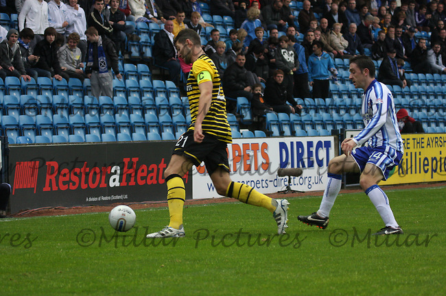 Charlie Mulgrew clearing under pressure from Paul Heffernan in the Kilmarnock v Celtic Clydesdale Bank Scottish Premier League match played at Rugby Park, Kilmarnock on 1.10.11