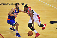 John Wall of the Wizards dribbles past Knicks' Jose Calderon. New York defeated Washington 115-104 during a NBA preseason game at the Verizon Center in Washington, D.C. on Friday, October 9, 2015.  Alan P. Santos/DC Sports Box