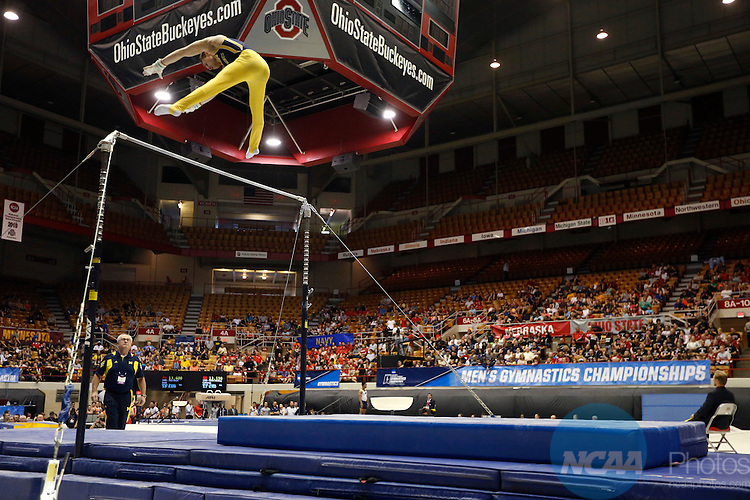 16 APR 2016:  Dmitri Belanovski, of Michigan, competes on the horizontal bar during the Division I Men's Gymnastics Championship held at St. John Arena on the Ohio State University campus in Columbus, OH. Oklahoma won the national title. Jay LaPrete/NCAA Photos