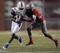 STAFF PHOTO ANDY SHUPE - Midland Christian receiver Zyan Burditt (8) carries the ball as Highland defensive back Deon Stewart defends during the first half of play Monday, Sept. 1, 2014, at Razorback Stadium in Fayetteville.