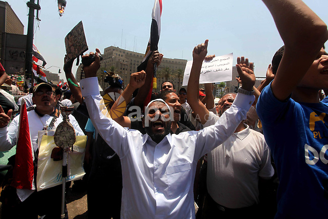 Egyptian protesters hold placards and shout slogans against the presidential candidate Ahmed Shafik, during a protest in Tahrir Square, Cairo, Egypt, 01 June 2012. Media reports state that hundreds of Egyptians held a demonstration to protest against Egyptian presidential candidate Ahmed Shafik, who was appointed premier in Mubaraks final days in power. The runoff is scheduled for 16-17 June, while the winner will be announced on 21 June. Photo by Ashraf Amra