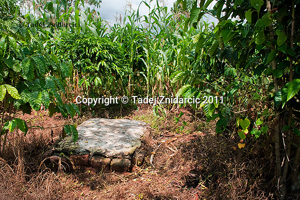 The grave of Nakato, one of Sylvia Nalubowa's twins who died during childbirth. Soweto village, Mityana district, Uganda. Sylvia Nalubowa died during childbirth in Mityana hospital in August 2009. She was giving birth to twins and one of the twins also died during childbirth..