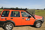 John Huntley driving the 2003 G4 Challenge Land Rover Freelander V6 event car. Dunsfold Collection of Land Rovers Open Day 2011, Dunsfold, Surrey, UK. --- No releases available, but releases may not be necessary for certain uses. Automotive trademarks are the property of the trademark holder, authorization may be needed for some uses. --- Vehicle Information: Vehicle belongs to the Dunsfold Collection of Land Rovers: Chassis number NABG12A211162, Registration BG52 VZV, Engine 2.5 V6 petrol , Gearbox 5-speed auto. --- Vehicle History: This Land Rover Freelander G4 was the photo car used to shuttle videos and spare parts to stages during the event in Australia in 2003. It has covered 12000 miles on very hard roads but is still in immaculate condition. The orange colour is special to this event as are a lot of the accessories. There is provision for a detachable warn winch front and rear, as well as a host of off road equipment.