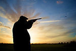 Pix: Shaun Flannery/sf-pictures.com..COPYRIGHT PICTURE>>SHAUN FLANNERY>01302-570814>>07778315553>>..19th December 2008...............Loversall 'game shoot' in Doncaster, South Yorkshire..A gun takes a shot at a pheasant on the last drive of the day as the sun sets.