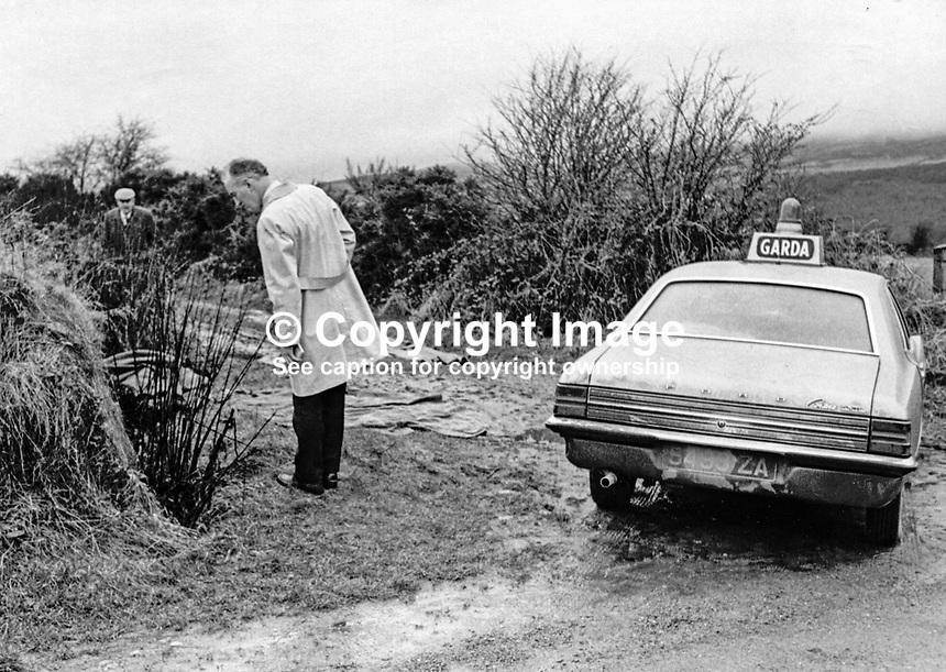 Garda detectives at the murder scene of Oliver Boyce, Clonmany, and his fiancee, Briege Porter, Buncrana, both from Co Donegal, random victims, who were stabbed and then shot by the UDA/UFF on their way home from a New Year's Eve dance just over the N Ireland/Rep of Ireland border. 197301010011..Copyright Image from Victor Patterson, 54 Dorchester Park, Belfast, United Kingdom, UK...For my Terms and Conditions of Use go to http://www.victorpatterson.com/Victor_Patterson/Terms_%26_Conditions.html