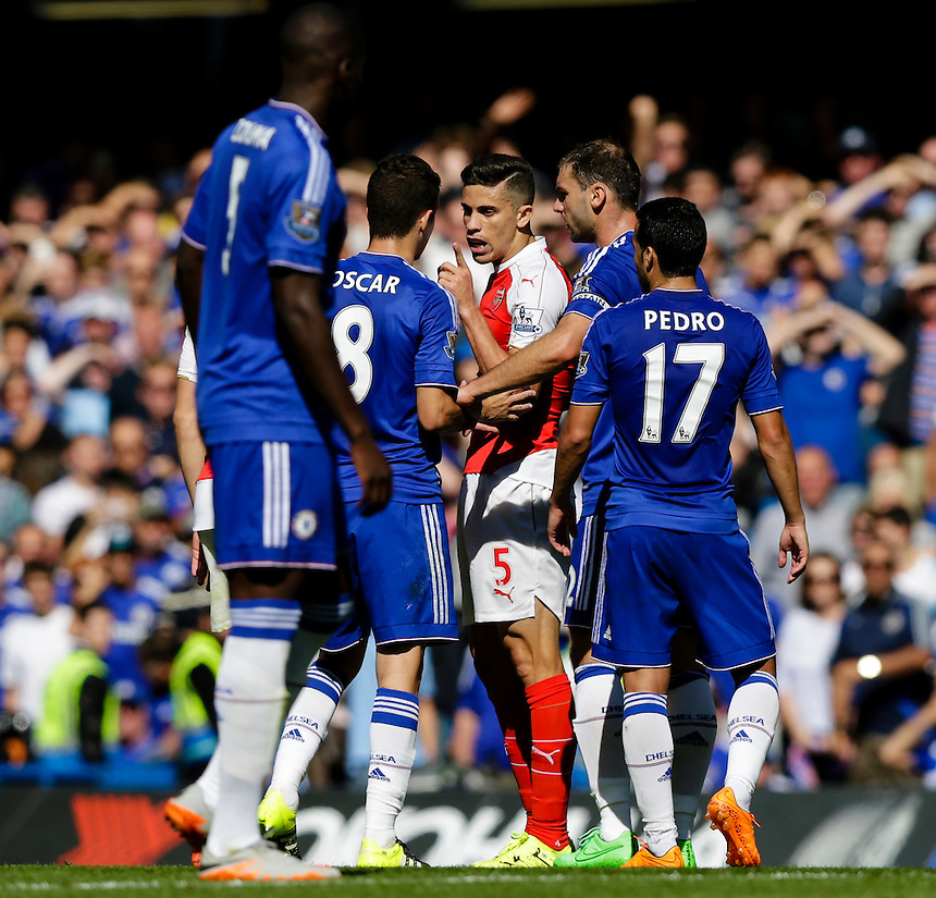 Arsenal's Gabriel Paulista talks forcefully with Chelsea's Oscar after his sending off<br /> <br /> Photographer Craig Mercer/CameraSport<br /> <br /> Football - Barclays Premiership - Chelsea v Arsenal - Saturday 19th September 2015 - Stamford Bridge - London<br /> <br /> &copy; CameraSport - 43 Linden Ave. Countesthorpe. Leicester. England. LE8 5PG - Tel: +44 (0) 116 277 4147 - admin@camerasport.com - www.camerasport.com