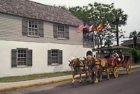 AJ4016, St. Augustine, horse-drawn carriage, Florida, Horse-drawn carriage passes in front of the oldest house, the Gonzalez-Alvarez House, in Saint Augustine in the state of Florida. St. Augustine is the oldest settlement in the United States.