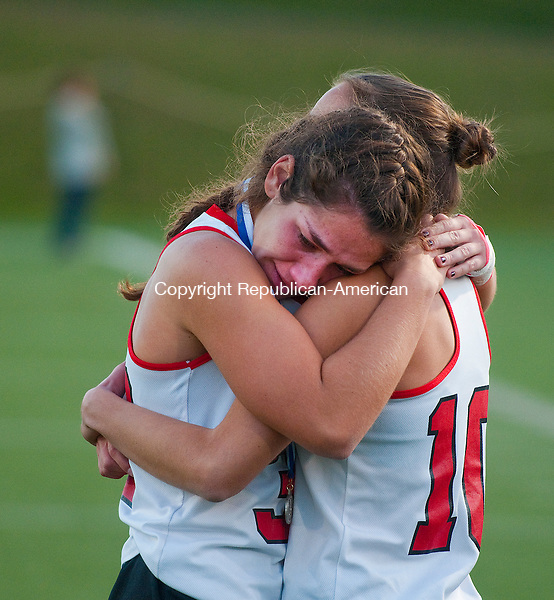 WETHERSFIELD, CT--- -112115JS16--Cheshire's Nicole Salamone (33) is consoled by teammate Samantha Vitale (10) following their 1-0 overtime loss to Wilton in the Class L state finals Saturday at Wethersfield High School.<br /> Jim Shannon Republican-American