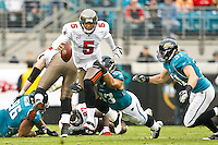 December 11, 2011:  Tampa Bay Buccaneers quarterback Josh Freeman (5) scrambles out of the pocket and is tackled by Jacksonville Jaguars defensive tackle Tyson Alualu (93) during first half action between the Jacksonville Jaguars and the Tampa Bay Buccaneers played at EverBank Field in Jacksonville, Florida.  ........