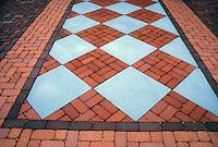Patio of brick and bluestone pavers in ornamental pattern