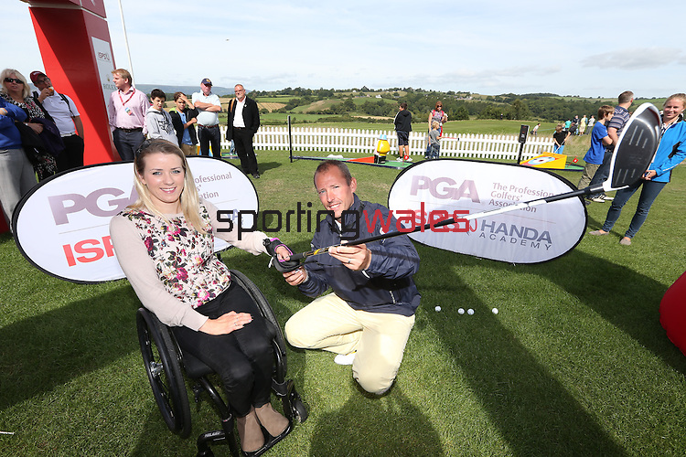 Paralympic discus champion Josie Pearson having her first golf lesson from ISPS Handa professional Craig Thomas at the ISPS Handa Wales Open 2013<br /> Celtic Manor Resort<br /> <br /> 01.09.13<br /> <br /> ©Steve Pope-Sportingwales