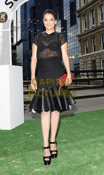 Julie Gonzalo.The Channel 5 Launch Party for the new series of 'Dallas', Old Billingsgate Market, London, England..21st August 2012.full length black sheer blouse skirt see through thru bra leather red clutch bag sandals.CAP/DH.©David Hitchens/Capital Pictures.