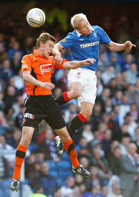 Steven Naismith uses his rocket boots to leap over Paul Dixon and win the ball