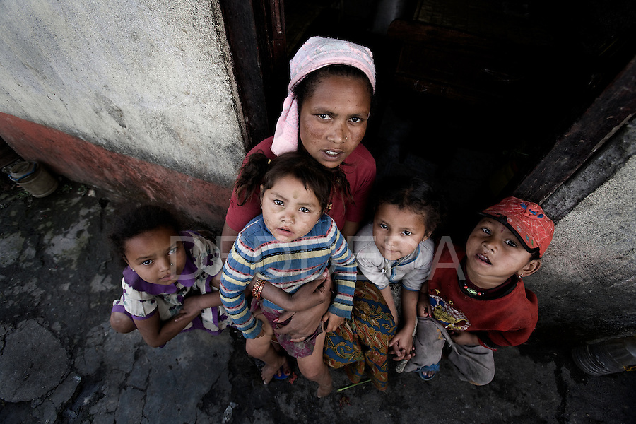 A mother sits with her four children in a poverty-stricken neighbourhood of Pokhara, Nepal.