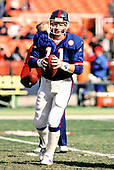 New York Giants quarterback Phil Simms warms-up prior to his game against the Washington Redskins at RFK Stadium in Washington, DC on Sunday, December 7, 1986.<br /> Credit: Arnie Sachs / CNP