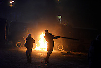 Rioters throw crowbars and molotov cocktails against police trucks during the   protest against new draconian law to ban the right to  protest across the country.  Kiev. Ukraine