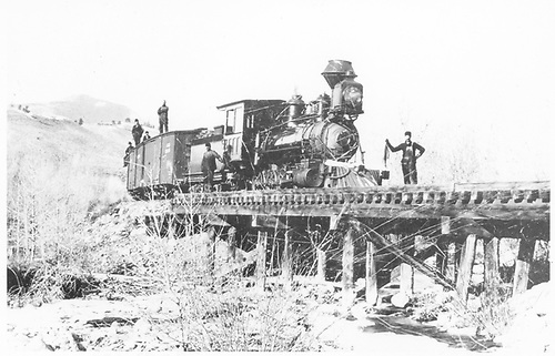 3/4 engineer's-side view of D&amp;RG #52 standing on a trestle east of Maysville.  The crew is posing.<br /> D&amp;RG  e. of Maysville, CO