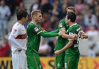 Fussball  1. Bundesliga  Saison 2013/2014  8. Spieltag VfB Stuttgart - SV Werder Bremen     05.10.2013 JUBEL Werder Bremen; Torschuetze zum 1-1 Ausgleich; Nils Petersen (Mitte) umarmt Zlatko Junuzovic (re) und Aaron Hunt (2.v.li.), Gotoku Sakai (VfB Stuttgart) enttaeuscht