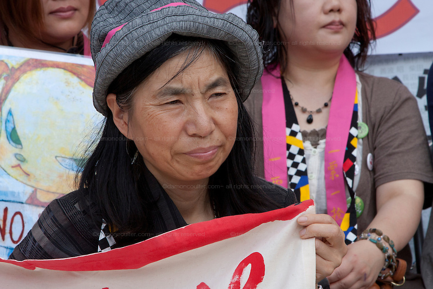 Sachiko Saito at the Women`s Protest outside METI (Ministry of Economy, Trade and Industry) in Tokyo, Japan. Friday June 29th 2012. About 400 protesters campaigned the restarting of the Oi nuclear power-station and the policy of Prime-Minister Noda to restart Japan's nuclear power generation programme which has been stalled since the earthquake and tsunami of March 11th 2011 caused meltdown and radiation leaks at the Fukushima Daichi Nuclear power-plant.
