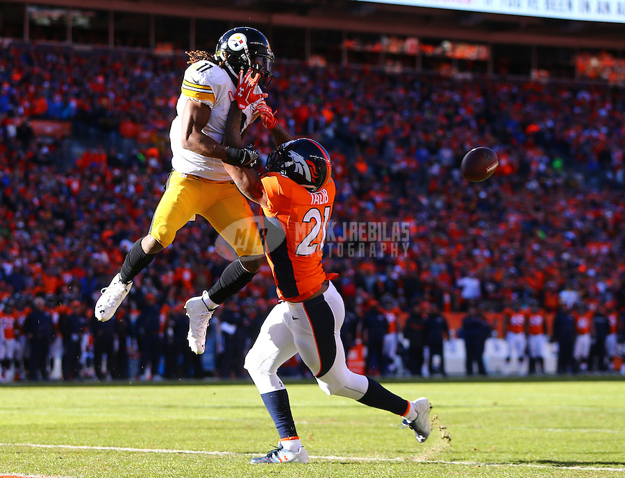 Jan 17, 2016; Denver, CO, USA; Pittsburgh Steelers wide receiver Markus Wheaton (11) attempts to catch a pass against Denver Broncos cornerback Aqib Talib (21) during the AFC Divisional round playoff game at Sports Authority Field at Mile High. Mandatory Credit: Mark J. Rebilas-USA TODAY Sports
