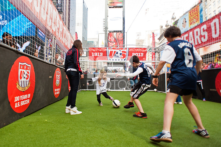 U.S. women national team midfielder Carli Lloyd watches a small sided game during the centennial celebration of U. S. Soccer at Times Square in New York, NY, on April 04, 2013.
