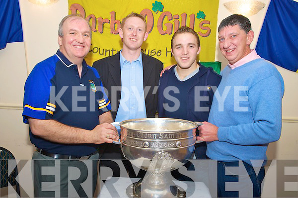 Pat Gill, Colm Cooper, Darran O'Sullivan and Ger Galvin with Sam,when the cup visited Darby O'Gills on Thursday night.