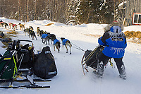 Hans Gatt pulls team into McGrath Chkpt McGrath Alaska Interior Winter 2006 Iditarod
