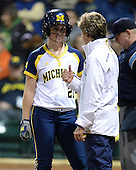 Michigan Wolverines Softball outfielder Kelly Christner (21) talks with coach Carol Hutchins during a game against the University of South Florida Bulls on February 8, 2014 at the USF Softball Stadium in Tampa, Florida.  Michigan defeated USF 3-2.  (Copyright Mike Janes Photography)