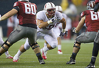 SEATTLE, WA - September 28, 2013: Stanford defensive tackle David Parry rushes the quarterback during play against Washington State at CenturyLink Field. Stanford won 55-17