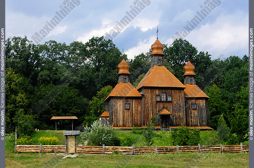 Stock photo of an Ancient wooden church house Ukraine Eastern Europe Pirogovo countryside scenic