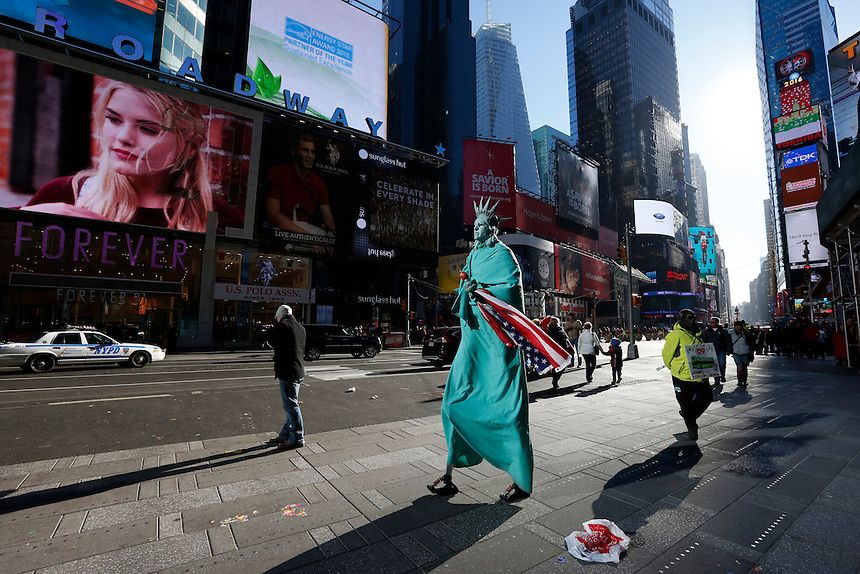 Lady Liberty takes a stroll through Times Square, Manhattan, NY.