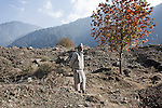 Atta Mohammed, the gravedigger of Chahal Village in Baramulla District, near the line of control. He has buried more than 250 bodies, including many young people and.children in this Mass graveyard, Kashmir 14 November, 2010.