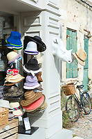 Typical street scene quaint house with shutters and hats on sale in gift shop in St Martin de Re, Ile de Re, France