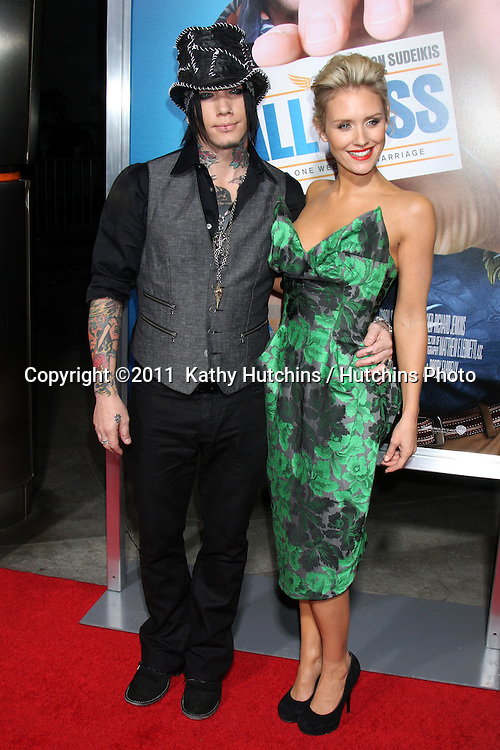 "LOS ANGELES - FEB 23:  D.J. Ashba, Nicky Whelan arrives at the ""Hall Pass"" Premiere at ArcLight Theaters on February 23, 2011 in Los Angeles, CA"