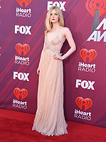 14 March 2019 - Los Angeles, California - Elle Fanning. 2019 iHeart Radio Music Awards held at Microsoft Theater. Photo Credit: Birdie Thompson/AdMedia
