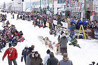 Saturday March 6 , 2010   Justin Savidis runs down 4th Avenue with a crowd of onlookers during the ceremonial start of the 2010 Iditarod in Anchorage , Alaska