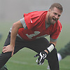Ryan Fitzpatrick #14 New York Jets quarterback laughs as he stretches during practice at the Atlantic Health Jets Training Jets Training Center in Florham Park, NJ on Wednesday, Dec. 30, 2015.
