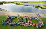 In the little town of Vlaardingen near Rotterdam, an estimated group of 1500 Scouts gathered to create this aerial image of 10:10. The event was organized by JMA (Jongeren Milieu Actief) in Amsterdam. The image reminds us of the goal to reduce emissions by 10% in 2010 as well as to get to work during and after the Global Work Party on October 10, 2010.