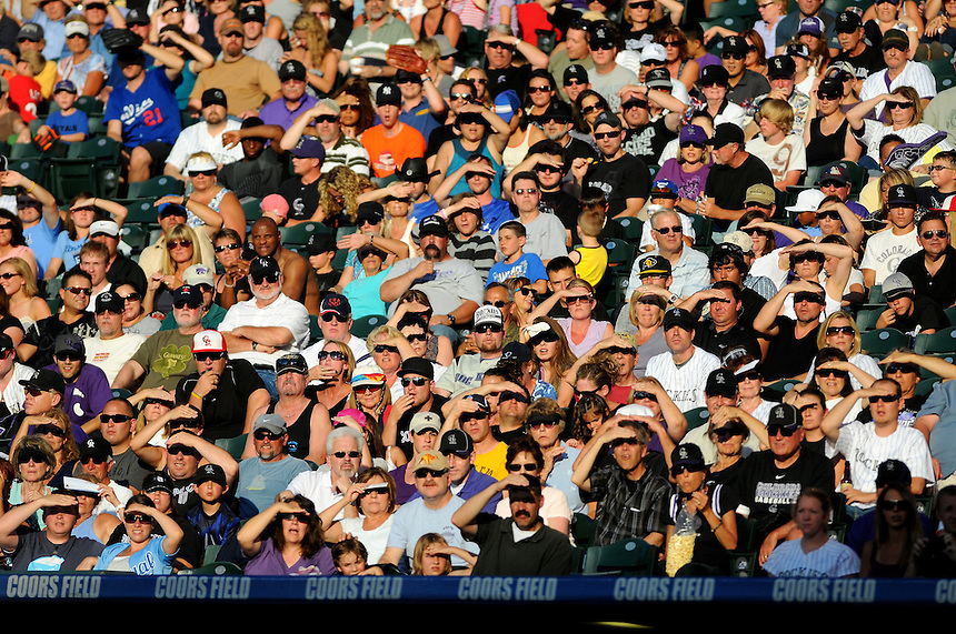 02 JULY 2011:      The crowd squints into the sun in this general view of the stands full of fans     during a regular season interleage game between the Kansas City Royals and the Colorado Rockies at Coors Field in Denver, Colorado. The Rockies beat the Royals 9-6.   *****For Editorial Use Only*****