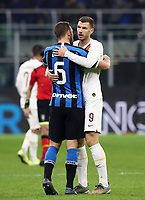 Calcio, Serie A: Inter Milano - AS Roma, Giuseppe Meazza stadium, December 6, 2019. <br /> Roma's Edin Dzeko (r) greets Inters' Stefan De Vrij (l) at the end of the the Italian Serie A football match between Inter and Roma at Giuseppe Meazza (San Siro) stadium, on December 6, 2019.<br /> The result of the match is 0-0.<br /> UPDATE IMAGES PRESS/Isabella Bonotto
