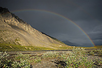 A rainbow forms after a rainstorm over the Canning River in Alaska's Arctic National Wildlife Refuge.