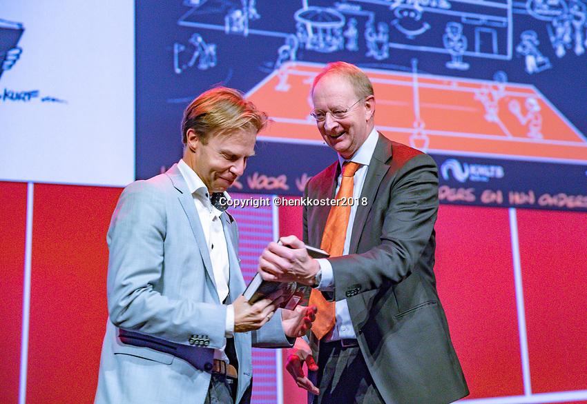 Nieuwegein,  Netherlands, 24 November 2018, KNLTB Year congress KNLTB, Berentd Rubingh hands out  the first book to KNLTB Director Erik Poel (L)<br /> Photo: Tennisimages.com/Henk Koster