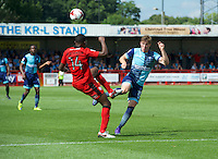 Dayle Southwell of Wycombe Wanderers and Andre Blackman of Crawley Town challenge for the ball during the Sky Bet League 2 match between Crawley Town and Wycombe Wanderers at Broadfield Stadium, Crawley, England on 6 August 2016. Photo by Alan  Stanford / PRiME Media Images.